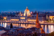 The Hungarian Parliament Building And River Danube At Night, UNESCO World Heritage Site, Budapest, Hungary
