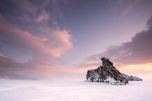 Rocky Island On A Frozen Lake Baikal, Siberia, Russia