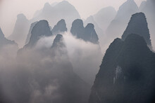 Misty Morning With Fog And Low Clouds On The Peaks Above Li River, Guangxi, China