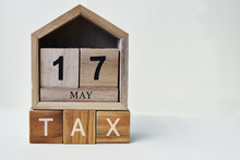Tax Day Concept With Wooden Calendar 17 May And Cube, Copy Space Text.