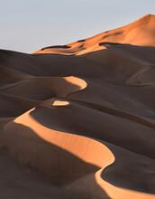 Sand Dunes At Sunset In The Rub Al Khali Desert, Oman, Middle East