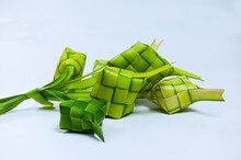 Ketupat: Food Containing Steamed Or Sticky Rice, Usually Eaten With Curry Or Curry, This Food Is Cooked During The Eid Celebrations