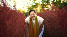 Asian Senior Woman Smile Happy In Red Flower Field Happy Leisure Retirement Lifestyle