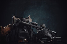 Militray Equipment And Weapons On A Table In Dark Background