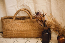 Dry Protea Flower In Vase, Pampas Grass, Wicker Basket On Rug. Bohemian Room Decor. Boho Details