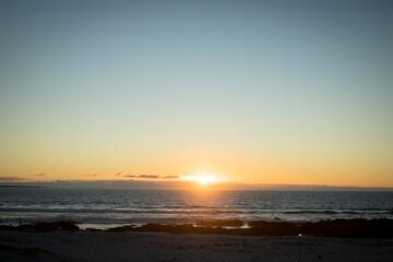 Sunset on beach at the sea