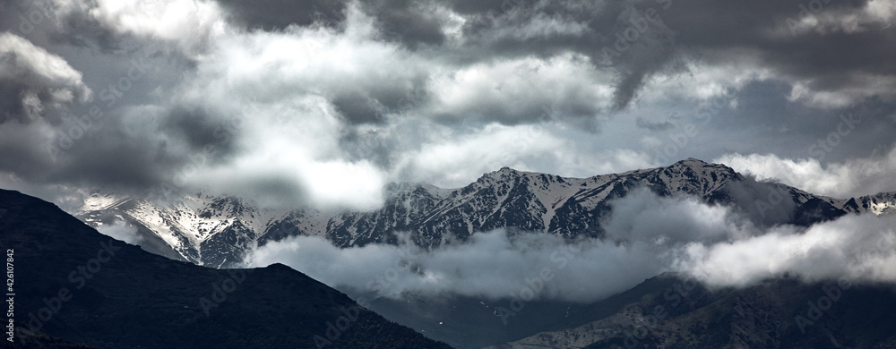 Fototapeta snowy mountain under dark sky