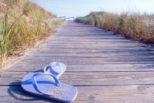 United States, New Jersey, Spring Lake, Flip Flops On Boardwalk To Beach