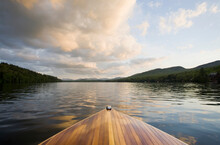 United States, New York, Lake Placid, Wooden Boat On Lake Placid At Sunset