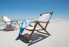 Empty Beach Chairs With Bag And Towel On Beach