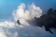 United States, Oregon, Waves Splashing At Rocky Coastline During Storm