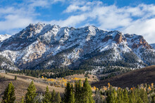 United States, Idaho, Sun Valley, Landscape With Snowcapped Rocky Mountains And Autumn Forests In Valleys