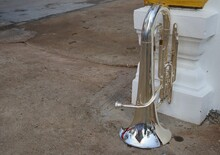 Old Brass Euphonium Three Valves Are Visible And Attached To The Mouthpiece. Put On The Cement Floor Selectable Focus