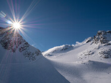 Canada, British Columbia, Snowy Mountains With Sun Flare
