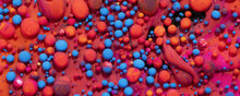 Top View Of Colorful Vibrant Rocks On A Bright Red Surface For Wallpapers And Backgrounds