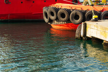 The Hull Of The Red Sea Boat. The Stern Of The Ship In The Sea Near The Pier. Marina Pier In Istanbul