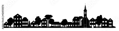 Obraz na plátně Small Town silhouette cutout skyline with chapel houses trees black and white