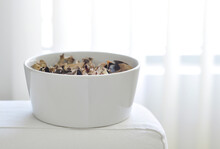 A Contemporary White Bowl Filled With Aromatic Potpourri.