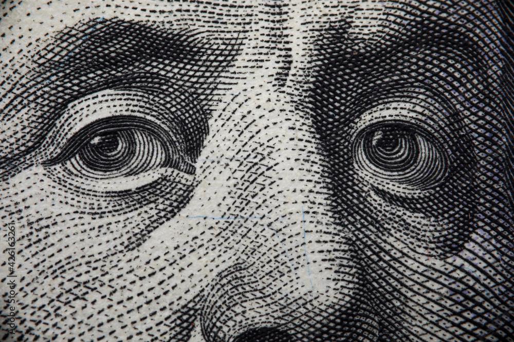 Fototapeta Close-up of benjamin franklins face on hundred banknote