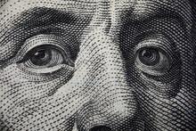 Close-up Of Benjamin Franklins Face On Hundred Banknote