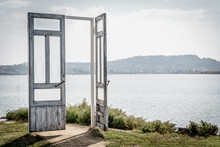 Symbolic Wooden Open Door On A Lake, Concept Of An Open Door To Nature And Climate Change