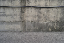 Old Weathered Concrete Wall By The Road