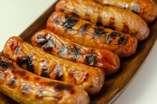 Grilled Classic British Sausage Made From Prime Cuts Of Pork On The Wooden Plate