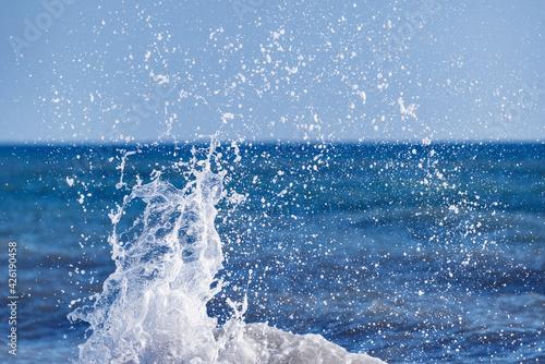 Obraz na plátně Wave of the sea water at sunny day time.
