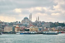 Turkey Istanbul 03.03.2021. Old And Ancient Ottoman Mosques Yeni Cami Mosque In Istanbul Turkey During Morning By Taken Photo From Istanbul Bosporus.