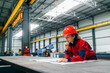 canvas print picture Construction engineer at heavy industry factory, working on blueprint.