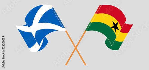Fotografia, Obraz Crossed and waving flags of Scotland and Ghana