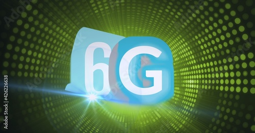 Composition of the word 6g over a tunnel of green dots in background