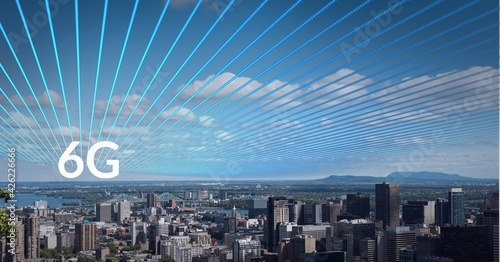 Composition of the word 6g over a cityscape with blue lines on the sky in background