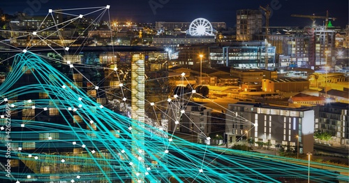 Composition of net of connections over a cityscape with blue lines in background