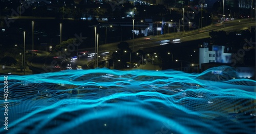 Composition of blue waves over a cityscape in background