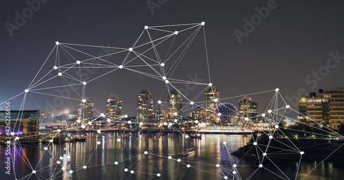 Composition of net of connections over a cityscape in background