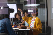 Diverse Group Of Creative Colleagues Using Vr Headset In Meeting Room