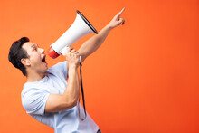Asian Man Holding Megaphone And Shouting