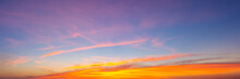 Beautiful Sky Painted By The Sun Leaving Bright Golden Shades.Dense Clouds In Twilight Sky In Winter Evening.Image Of Cloud Sky On Evening Time.