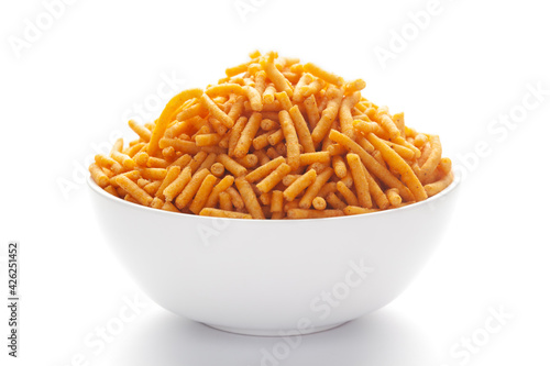 Tela Close up of Nimbu masala besan sev Indian namkeen (snacks) on a ceramic white bowl