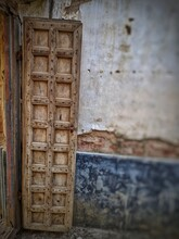 Vintage Old Warehouse Wooden Brown Painted Door With Ancient Brick Wall Of Limestone. Front View Of Gates To Abandoned Warehouse In India