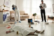 Investigators Working At Crime Scene With Dead Body