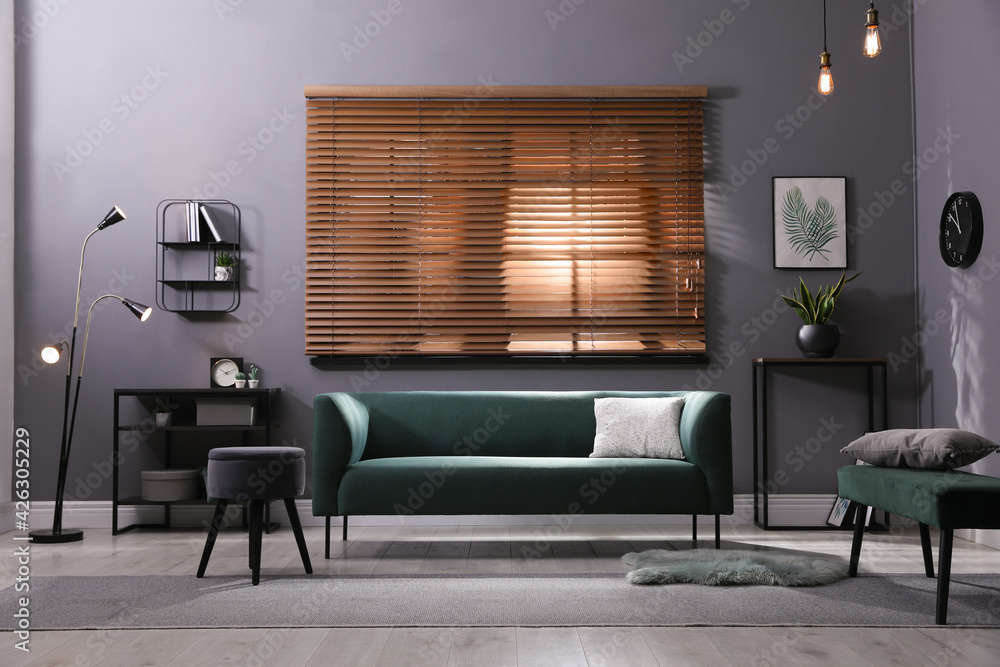 Fototapeta Stylish living room interior with comfortable green sofa and cushion