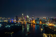 Aerial view of Ho Chi Minh city, Vietnam. Beauty skyscrapers along river light smooth down urban development. Dramatic lighting spectacular night.