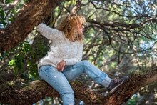 Young Woman Have Fun And Ejoy Trees And Forest In Outdoo Rleisure Activity - Happy Female People In The Woods