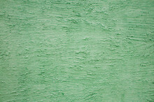 Textured Plaster Made On A Green-colored Wall. High Quality Photo