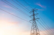 high-voltage power lines, high voltage electric transmission tower for producing electricity at high voltage electricity poles at the sunset.