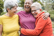 Multiracial Senior Women Having Fun Together After Sport Workout Outdoor - Friendship Concept - Main Focus On African Female Face