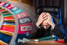 Upset Man Next To A Tape Measure. Roulette Table. Concept - Losing In The Casino. Human Is Ill With Gambling Addiction. Man Lost Money In The Casino. Adult Man Holds Onto The Headline. Roulette Table