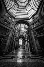 Grayscale Vertical Shot Of The Galleria Umberto In Naples, Italy